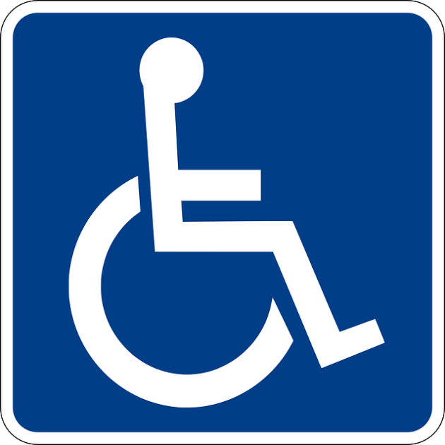 A white symbol of a person in a wheelchair appears on a square blue background.